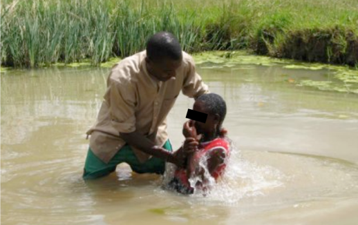 Figure 2: Full immersion Christian water baptism. Credit: DailyAdvent